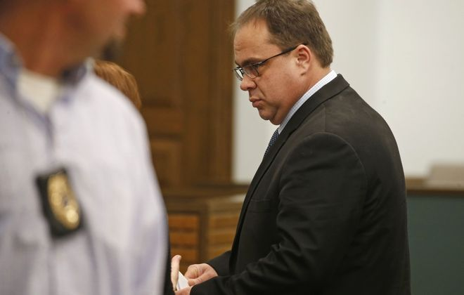 Kenneth Achtyl stands during his sentencing at Orchard Park Town Court on Thursday. (Robert Kirkham/Buffalo News)