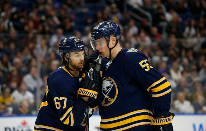 Buffalo Sabres defenseman Rasmus Ristolainen and Michael Frolik talk prior to a faceoff against the Vegas Golden Knights during the second period at KeyBank Center, Tuesday, Jan. 14, 2020. (Harry Scull Jr./Buffalo News)