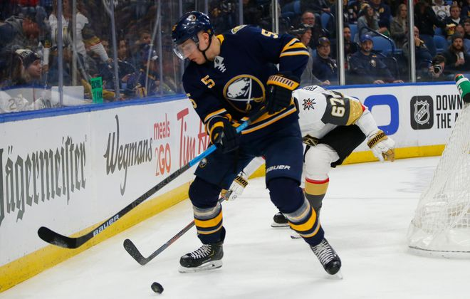 Buffalo Sabres defenseman Rasmus Ristolainen clears the puck against Vegas forward Max Pacioretty during the second period at KeyBank Center. (Harry Scull Jr./Buffalo News)