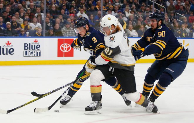 Buffalo Sabres players Jack Eichel and Marcus Johansson tie up Vegas Golden Knights forward Cody Eakin during the second period at the KeyBank Center, Tuesday, Jan. 14, 2020. (Harry Scull Jr./Buffalo News)