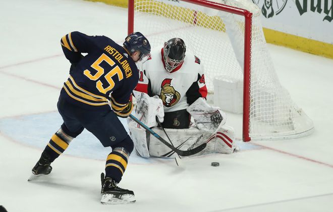 Ottawa Senators goaltender Craig Anderson (41) makes a save on a shot from Buffalo Sabres defenseman Rasmus Ristolainen (55) in the third period at KeyBank Center on Tuesday, Jan. 28, 2020. (James P. McCoy/Buffalo News)