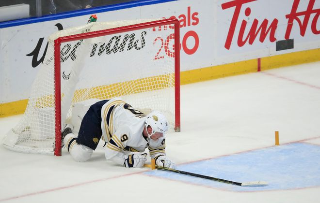 Jack Eichel kneels on the ice after the Sabres gave up an empty-net goal to the Montreal Canadiens that clinched Thursday's game. (Harry Scull Jr./Buffalo News)