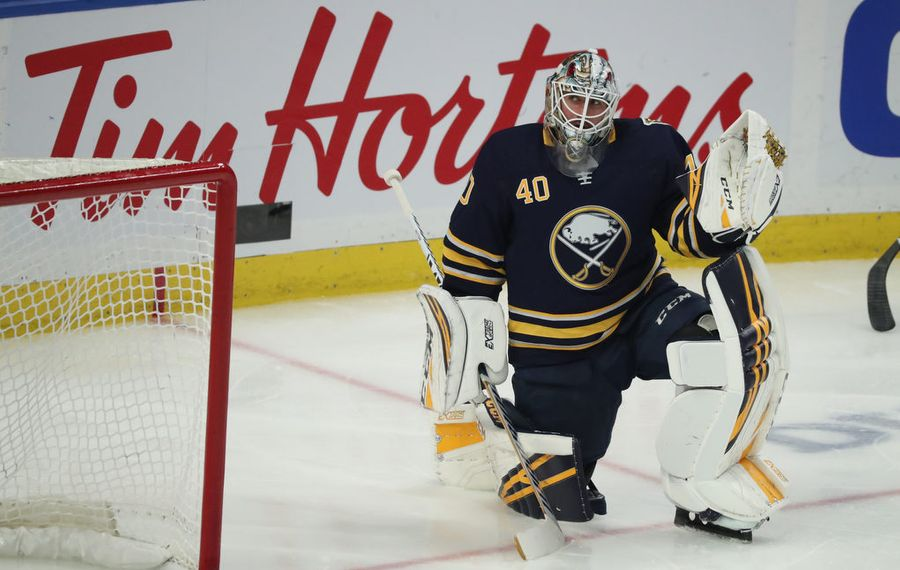 A frustrated Carter Hutton ponders the goal by Vancouver's Brock Boeser that snapped a 3-3 tie early in the third period (James P. McCoy/Buffalo News).