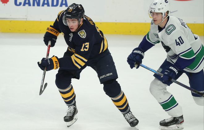 Buffalo Sabres left wing Jimmy Vesey (13) battles Vancouver Canucks center Elias Pettersson (40) for the puck in the third period at KeyBank Center on Saturday, Jan. 11, 2020. (James P. McCoy/Buffalo News)