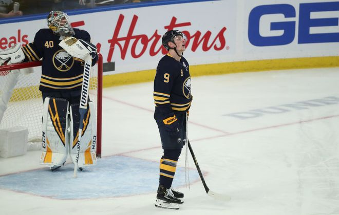 Buffalo Sabres goaltender Carter Hutton (40)  and Buffalo Sabres center Jack Eichel (9) look at the score board for the replay of the Vancouver Canucks fifth goal of the game in the third period at Key Bank Center in Buffalo, NY on Saturday, Jan. 11, 2020.  James P. McCoy/Buffalo News