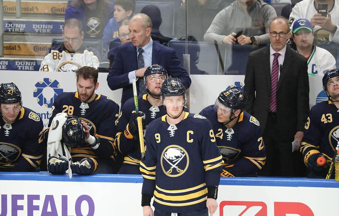 Ralph Krueger stands behind the Sabres' bench during a recent game at KeyBank Center. (James P. McCoy/News file photo)