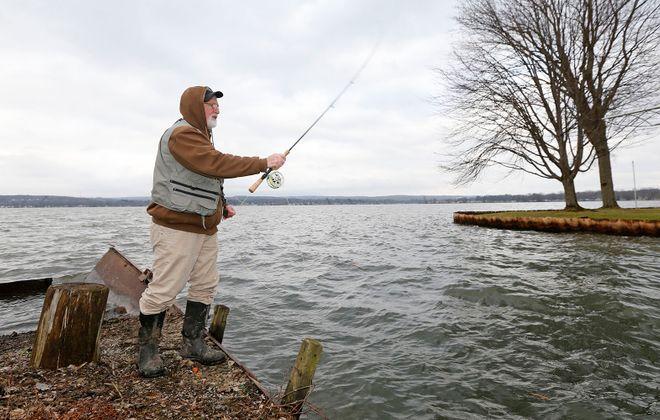Fisherman Randy Smith of Busti fishes for Perch in Lakewood on Monday, Jan. 13, 2020. (Robert Kirkham/Buffalo News)