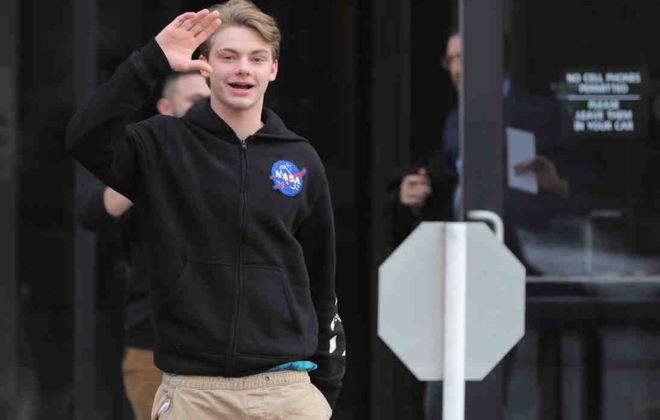 Christian McCaffrey, 18, of Amherst, shown in January leaving Amherst Town Court, where he appeared on a charge of aggravated harassment as a hate crime. (John Hickey/Buffalo News)