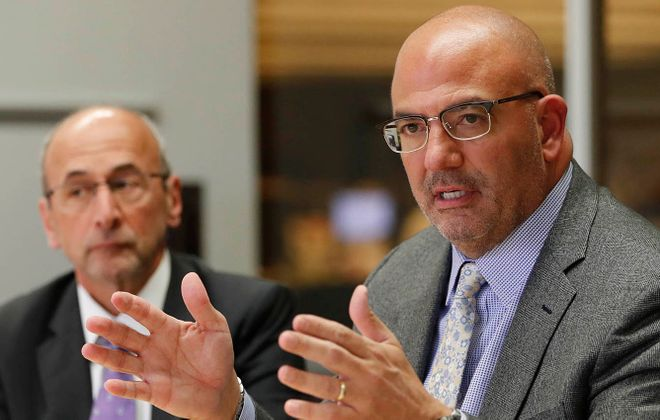 Kaleida Health President and CEO Jody Lomeo, with Kaleida Chairman Frank Curci in the background, plans to step down at the end of 2020. (Sharon Cantillon/Buffalo News)