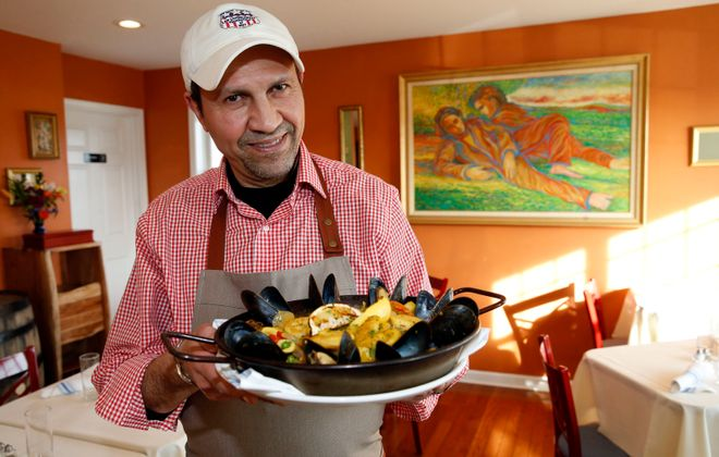 Owner and chef Sam Reda with the Seafood Paella at Zobud Bistro in Grand Island. (Robert Kirkham/Buffalo News)