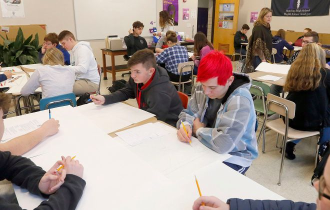 Students work on a project in Doreen Morris' health class at Hamburg High School on Jan. 31. (Mark Mulville/Buffalo News)
