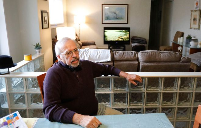 Joe Mascia sits in his apartment at the Buffalo Municipal Housing Authority's Marine Drive Apartments. Mascia and his wife live in the waterfront complex, though their household income has hovered around $100,000 in recent years. (Derek Gee/Buffalo News)
