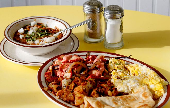 The Indian Special Breakfast is a popular choice at JJ's Cafe where you will find American and Indian choices. On the side is Chole Bhatura. (Robert Kirkham/Buffalo News)
