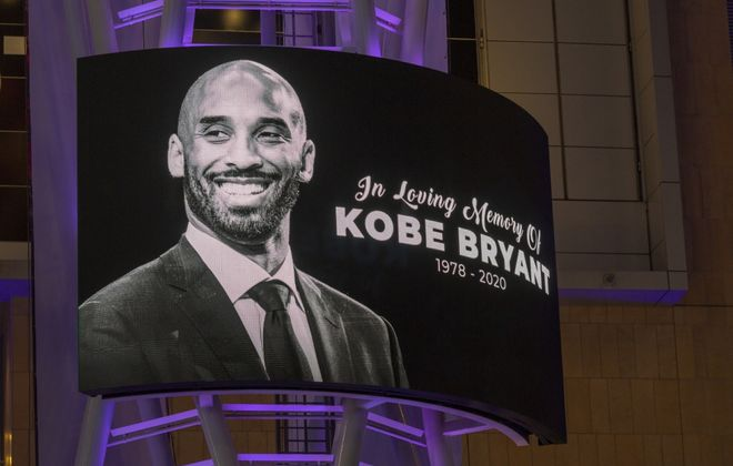 A memorial sign hangs on Staples Center for former NBA star Kobe Bryant, who was killed Sunday in a helicopter crash in Calabasas, Calif. (David McNew/Getty Images)