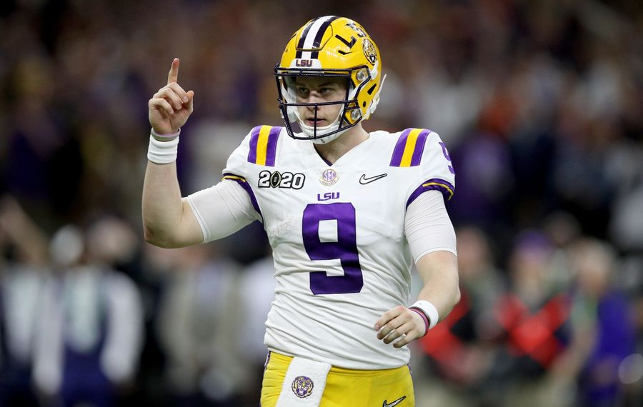 Joe Burrow (9) of the LSU Tigers reacts to a touchdown against the Clemson Tigers during the third quarter in the College Football Playoff National Championship game at Mercedes Benz Superdome on Jan. 13, 2020, in New Orleans. (Chris Graythen/Getty Images)