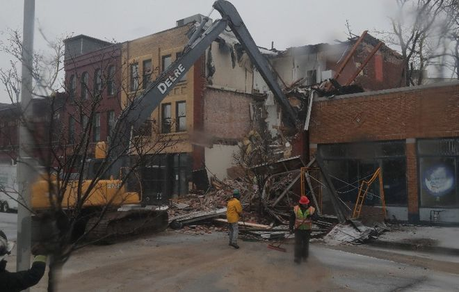 A systems failure led to the emergency demolition of a historic building at 435 Ellicott St.  in December. (John Hickey/Buffalo News)