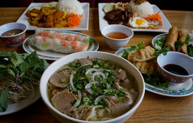 Pho Dac Biet, beef noodle soup with sliced rare beef, brisket, meatballs and tripe, foreground, at 99 Fast Food. (Derek Gee/Buffalo News)