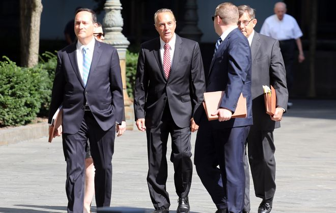 Buffalo Congressman Chris Collins (center) arrives at Federal District Court in Manhattan, New York City to plead guilty to insider trading on Oct. 1, 2019. (Jefferson Siegel/Special to The News)