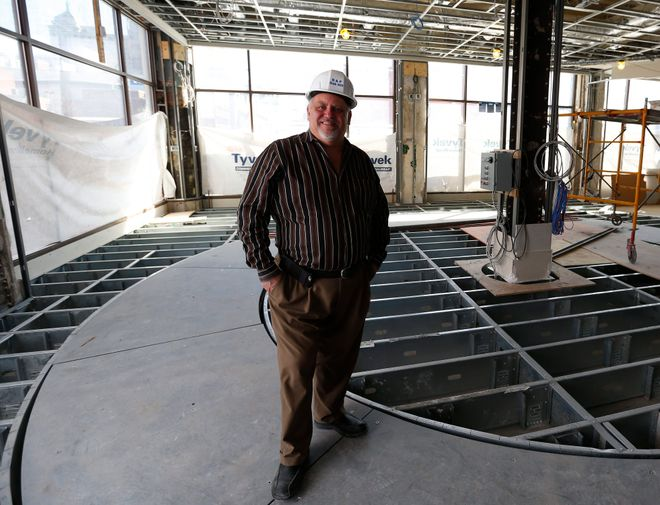 2016 photo of developer Mark Croce in the bar area during construction of  the Curtiss Hotel in Buffalo. (News file photo)