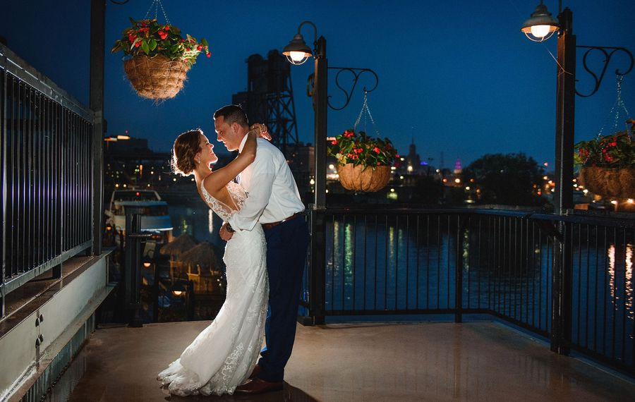 The couple married at the Canisius College Chapel in front of 274 friends to the tune of a beautiful string quartet, followed by a reception at Buffalo RiverWorks. (Kate Finnerty Photography)