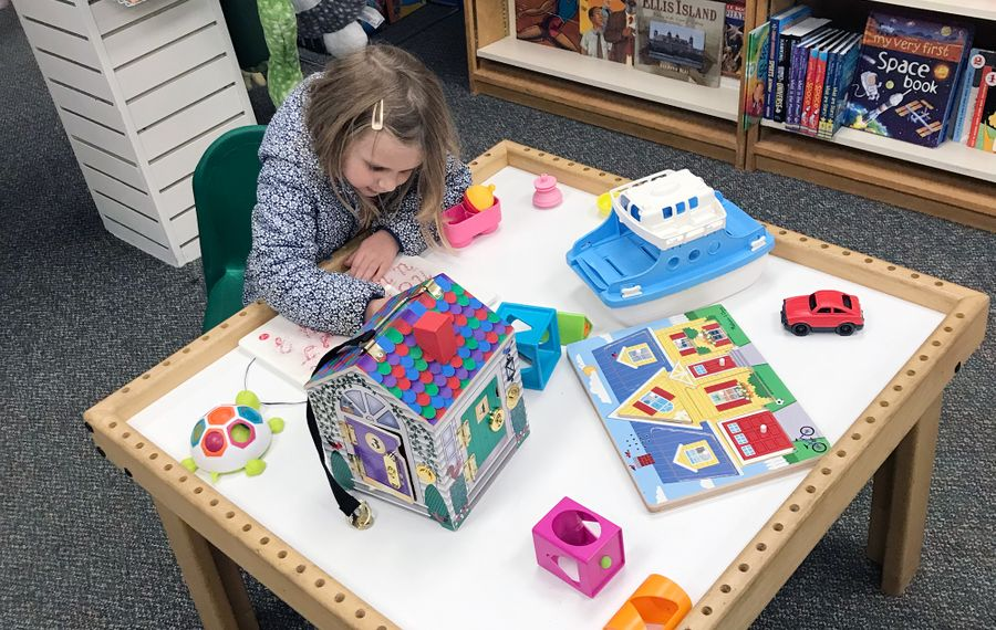 Writer Christopher Schobert's daughter takes a play break at Clayton's Toys in Williamsville. (Christopher Schobert)