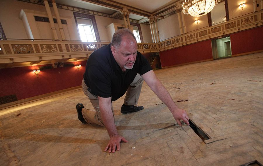 In 2011, Mark Croce showed The Buffalo News the herringbone floor in the Statler Golden Ballroom that had been damaged by wet carpet. (Sharon Cantillon/News file photo)