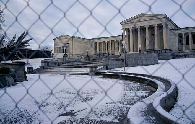 Fencing surrounds the Albright-Knox Art Gallery as construction begins on the landmark addition to the gallery for its AK360 campus expansion. (Derek Gee/Buffalo News)