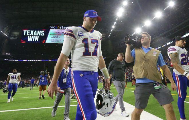 Josh Allen walks off the field. (James P. McCoy/Buffalo News)
