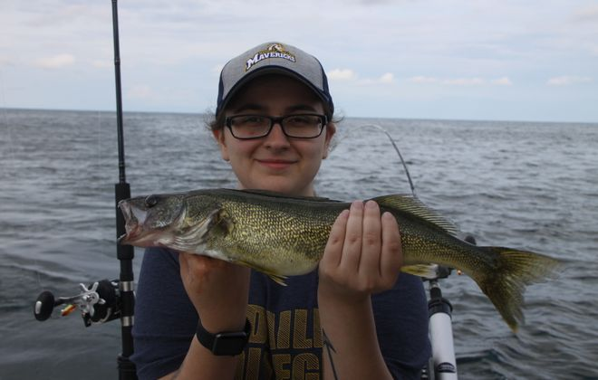 Ariah Haeick of Tonawanda shows off a typical Lake Erie walleye from 2019. The harvest rate set an all-time record last year and walleye fishing should continue to be above average in 2020. (Bill Hilts, Jr./Buffalo News)