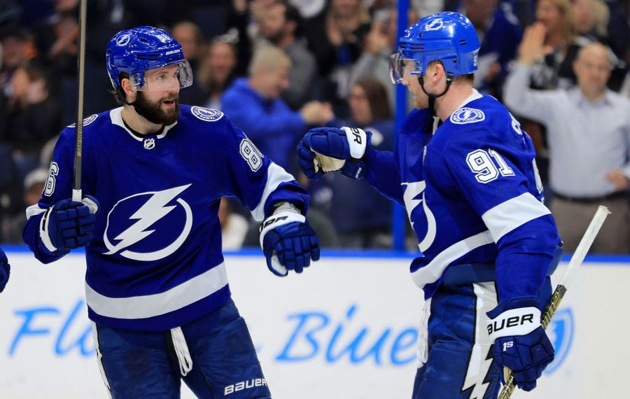 Nikita Kucherov, left, and Steven Stamkos led the surging Lightning to a 9-2 rout of the Canucks on Tuesday (Getty Images).