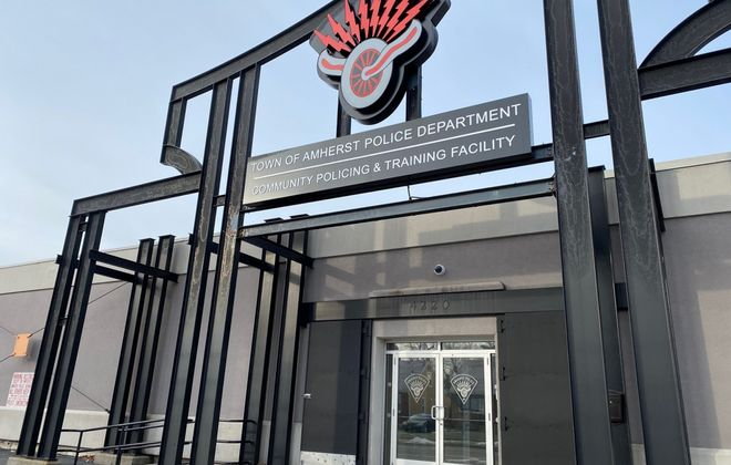 The Town of Amherst plans to build a $2 million shooting range inside this former Harley Davidson dealership that it spent $2.1 million to buy and update as a community policing and training center. (Stephen T. Watson/Buffalo News)
