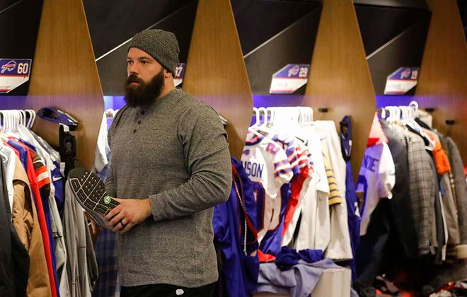 Bills center Mitch Morse packs his belongings Sunday after his team was eliminated from the playoffs the day before by the Houston Texans. (Derek Gee/Buffalo News)