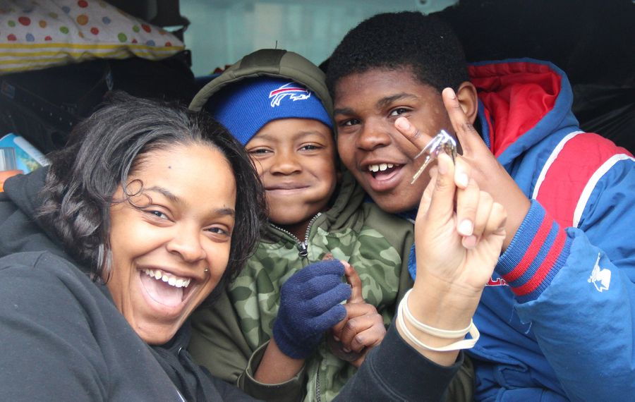 Victoria and her sons on the day they moved on from Family Promise of WNY—and into their new home. (Family Promise of WNY)