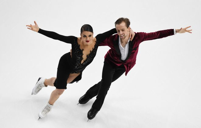 Kaitlyn Hawayek and her partner Jean-Luc Baker of the United States compete in the Ice Dance Rhythm Dance competition during the ISU Four Continents Figure Skating Championship. (Mark Ralson/AFP via Getty Images)