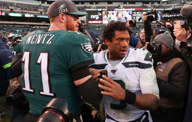 Duel between Eagles QB Carson Wentz and Seahawks QB Russell Wilson should make for a fun game. Above, the two after the Seahawks defeated the Eagles 17-9 on Nov. 24.(Getty Images)