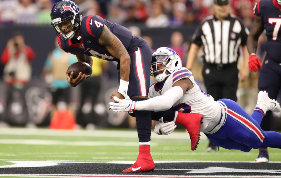 Bills defensive end Jerry Hughes makes one of his three sacks of Houston Texans quarterback Deshaun Watson on Saturday in an AFC wild-card playoff game. (Getty Images file photo)