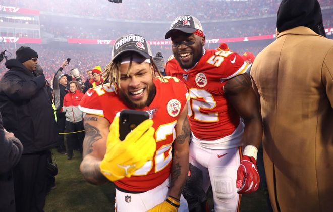 Tyrann Mathieu and Demone Harris of the Kansas City Chiefs celebrate after defeating the Tennessee Titans 35-24 in the AFC championship game at Arrowhead Stadium on Jan. 19, 2020. (Getty Images)