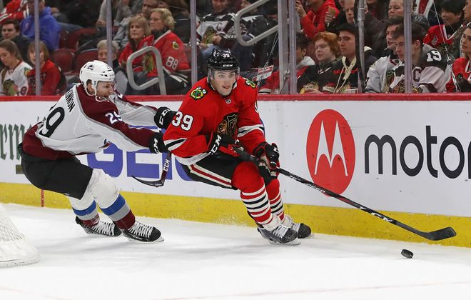 Chicago defenseman Dennis Gilbert works the puck against Colorado's Nathan MacKinnon during a game last month in United Center. (Getty Images)