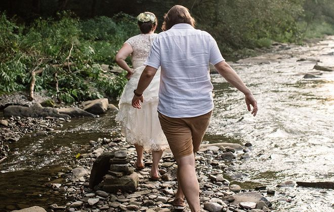 Gretchen and Summer were wed in the presence of their three shared loves: nature, pinball and each other. (Sarah Clapp)