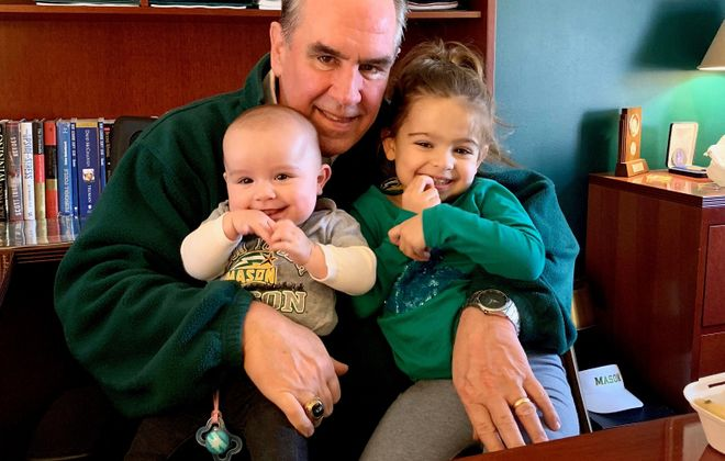 Kevin McNamee in his office with granddaughters Violet Lill and Evely Lill. (Photo courtesy of the McNamee family)