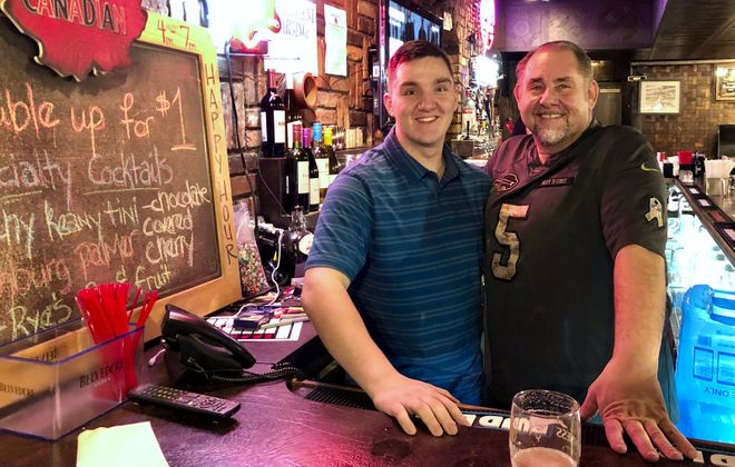 Owner Dean Puleo, right, and his son Tony Puleo behind the bar at the Grotto. (Ben Tsujimoto/Buffalo News)