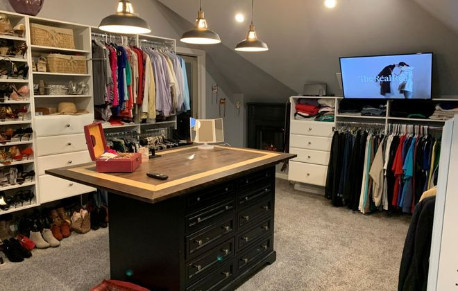 The new upper closet features custom storage, a center island, a fireplace and a 42-inch television. (Photo courtesy Michael McCartney)