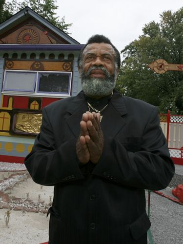 """Isaiah Robertson, seen on Oct. 3, 2007, in the early days of work on his """"Second Coming House"""" on Ontario Avenue in Niagara Falls. (News file photo)"""