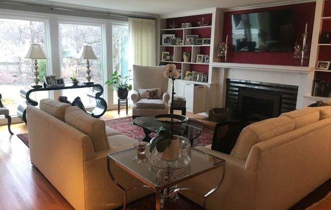 The living room features large windows. (Photo courtesy Nancy A. Gaglione)
