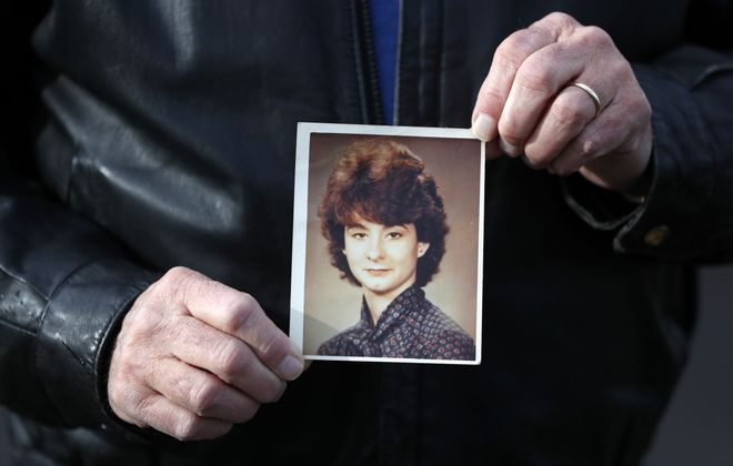 Retired West Seneca Police Detective Ed Tyzcka holds a picture of Leichia Reilly in the parking lot of the former Pierce Arrow restaurant in West Seneca on Jan. 6, 2020.  Reilly, 21, of West Seneca,  disappeared 35 years ago after allegedly leaving the tavern. She has never been found. (Mark Mulville/Buffalo News)