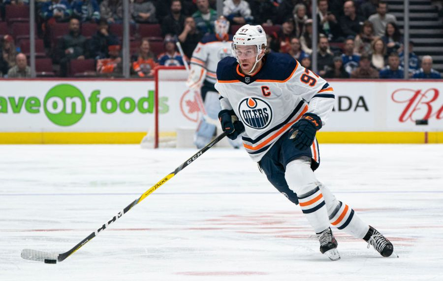 Connor McDavid leads the NHL in scoring with 64 points. (Getty Images)