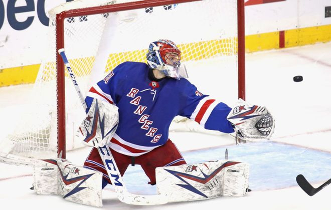 Rangers rookie Igor Shesterkin makes a save during Thursday's game against New Jersey (Getty Images).