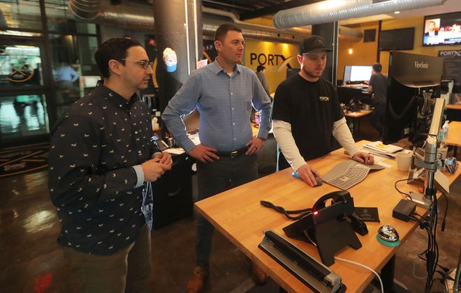 The former home of Lagerhaus 95 in the Cobblestone District is now being reused by a very different occupant: a nationwide trucking and logistics company. Co-owners Adam Cunningham, left, Pat Morrison and Tyler Pulbrook. (John Hickey/Buffalo News)