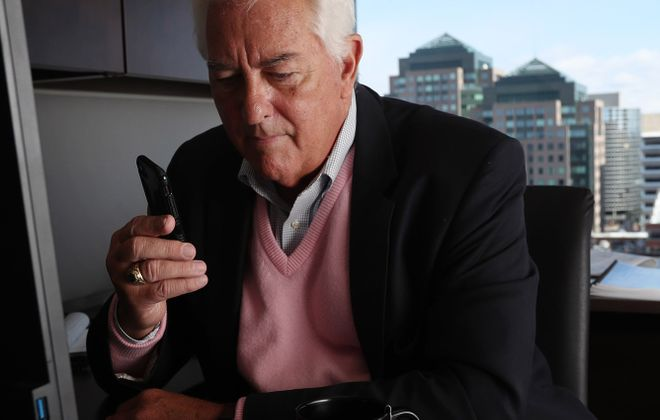 Former Congressman Jack Quinn is on a campaign: He's advocating for Parkinson's disease research, treatment and coverage, including for the boxing program he believes is changing lives.  Here Quinn works from his office at the law firm Barclay Damon, where he serves as a senior adviser. (Sharon Cantillon/News file photo)
