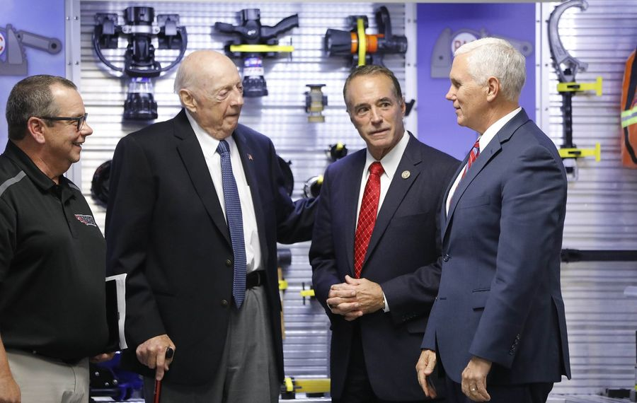 Vice President Pence, right, tours Performance Advantage Co. in Lancaster with company President Jim Everett, left, company founder Dick Young, center-left, and Rep. Chris Collins on Tuesday, Oct. 17, 2017.  Young defended Collins' move of repaying an old personal loan he had made to his 1998 congressional campaign with funds from his most recent campaign committee. (Derek Gee/Buffalo News)